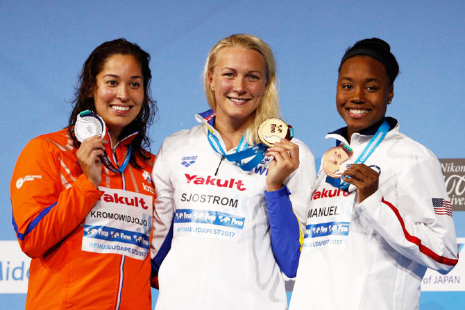 (Left-Right) Silver medalist Ranomi Kromowidjojo of the Netherlands, gold medalist Sarah Sjostrom of Sweden and bronze medalist Simone Manuel of the United States pose with the medals won in the Women's 50m Freestyle Final on Sunday