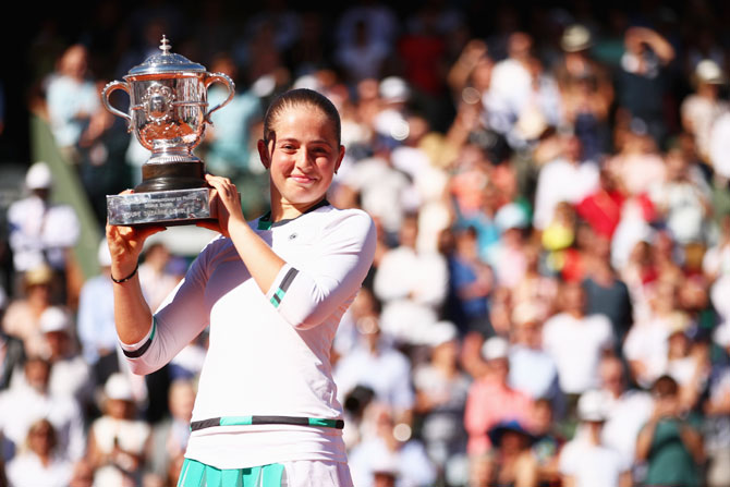 Latvia's Jelena Ostapenko with the Suzanne-Lenglen trophy following her French Open win over Romania's Simona Halep at Roland Garros in Paris on Saturday