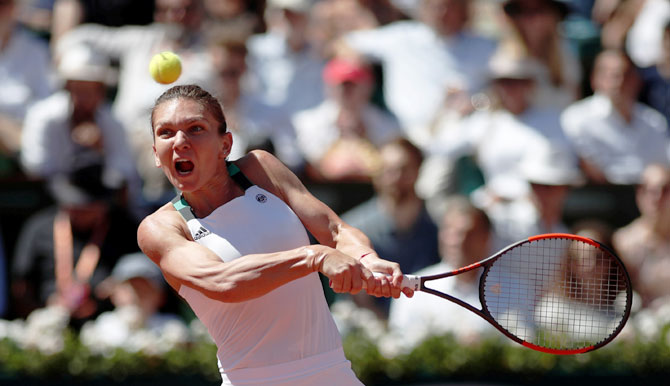 Simona Halep in action against Jelena Ostapenko in the French Open women's final at Roland Garros in Paris on Saturday