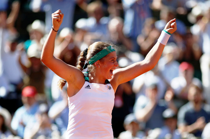 Latvia's Jelena Ostapenko celebrates winning the French Open final against Romania's Simona Halep
