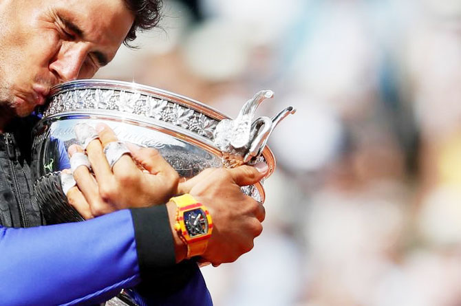 Rafael Nadal kisses the trophy after winning his 10th French Open title on Sunday