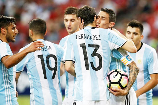 Argentina's Angel Di Maria (2nd R) celebrates with his teammates after scoring against Singapore during their international friendly at National Stadium in Singapore on Tuesday