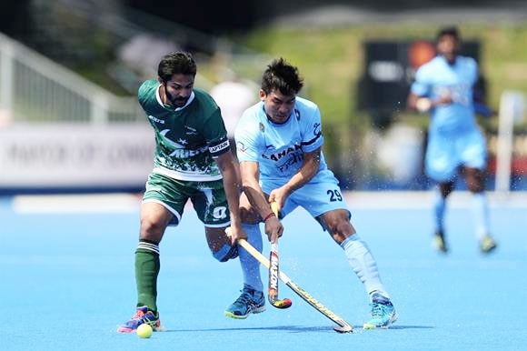 A Pakistan and an India player vie for possession