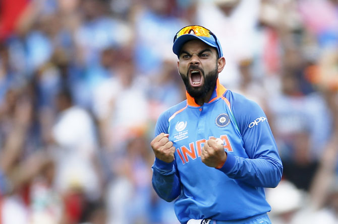 India's Virat Kohli celebrates the wicket of Pakistan's Shoaib Malik