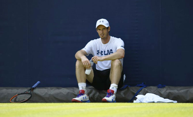 Andy Murray takes a breather during a training session at the Queen's Club in London on Monday