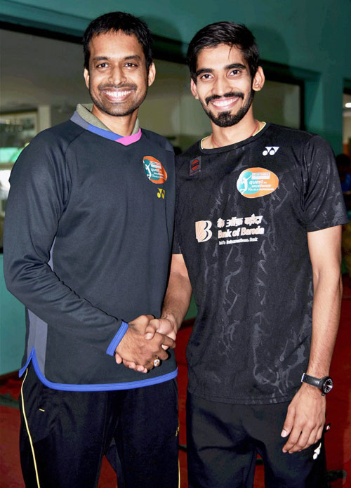 Gopichand greets K Srikanth before a press conference in Hyderabad on Tuesday