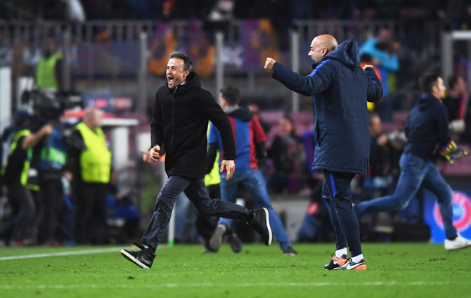 FC Barcelona (left) manager Luis Enrique celebrates as Sergi Roberto scores their sixth and winning goal on Wednesday