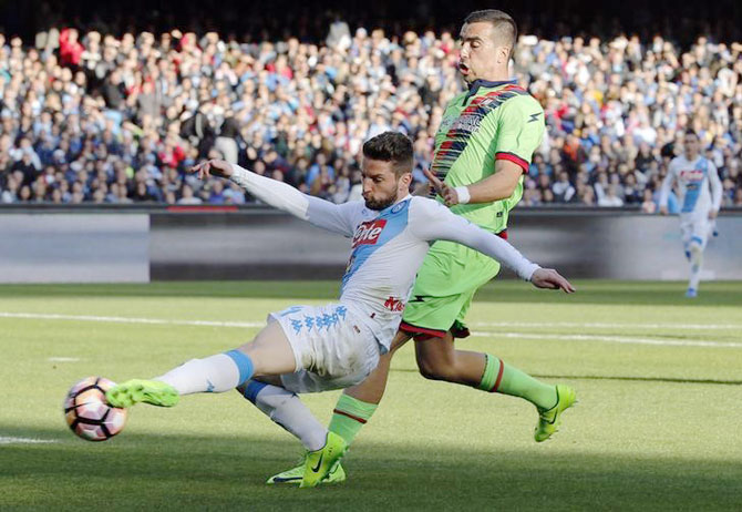 Napoli's Dries Mertens and Crotone's Noe Dussenne vie for possession during their Serie A match at San Paolo stadium, Naples, on Sunday