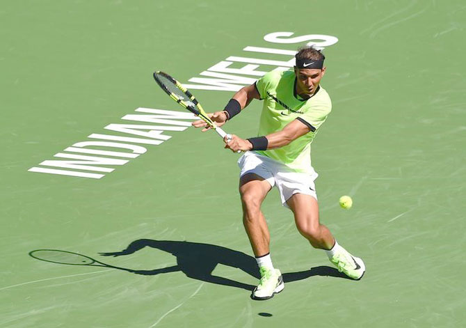 Spain's Rafael Nadal plays a return during his 2nd round win against Guido Pella in the BNP Paribas Open at the Indian Wells Tennis Garden on Sunday. Nadal won 6-3, 6-2.