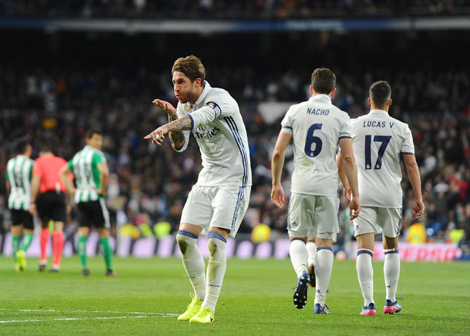 Real Madrid's Sergio Ramos celebrates after scoring the team's 2nd goal during their La Liga match against Real Betis Balompie at Estadio Santiago Bernabeu in Madrid on Sunday