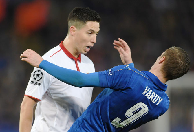 Leicester City's Jamie Vardy goes to the ground after butting heads with Sevilla's Samir Nasri during their UEFA Champions League Round of 16, second leg match at The King Power Stadium in Leicester, United Kingdom, on Wednesday. Nasri recieved a red card for the incident.