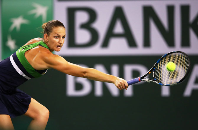 Rediff Sports - Cricket, Indian hockey, Tennis, Football, Chess, Golf - Pliskova battles past Muguruza to reach Indian Wells semis