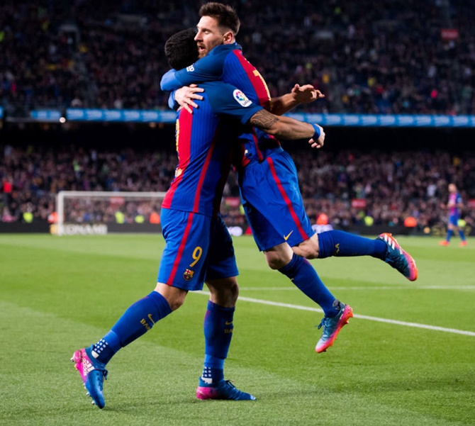 Rediff Sports - Cricket, Indian hockey, Tennis, Football, Chess, Golf - La Liga: Messi at double as Barca beat Valencia, Atletico see off stuttering Sevilla