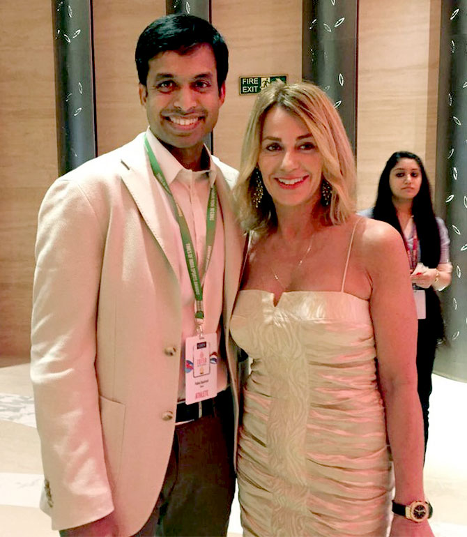 Romanian American gymnast Nadia Comaneci with Indian badminton player Pullela Gopichand