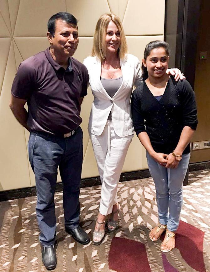 Romanian American gymnast Nadia Comaneci with Indian gymnast Dipa Karmakar and her coach Bishweshwar Nandi