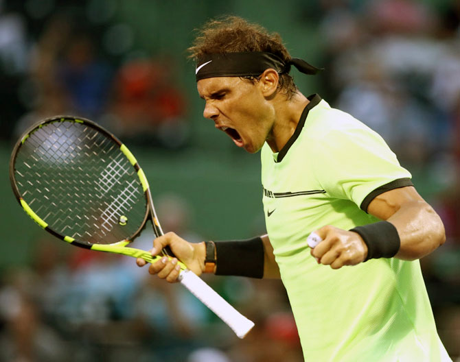 Rediff Sports - Cricket, Indian hockey, Tennis, Football, Chess, Golf - PHOTOS: Nadal wins in 1000th match, Raonic withdraws