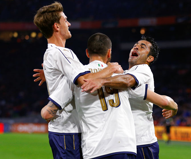 IMAGE: Italy's players celebrate a goal against the Netherlands.  Photograph: Michael Kooren