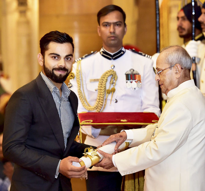 President Pranab Mukherjee presents the Padma Shri to cricketer Virat Kohli during Padma Awards 2017 function at Rashtrapati Bhavan in New Delhi on Thursday