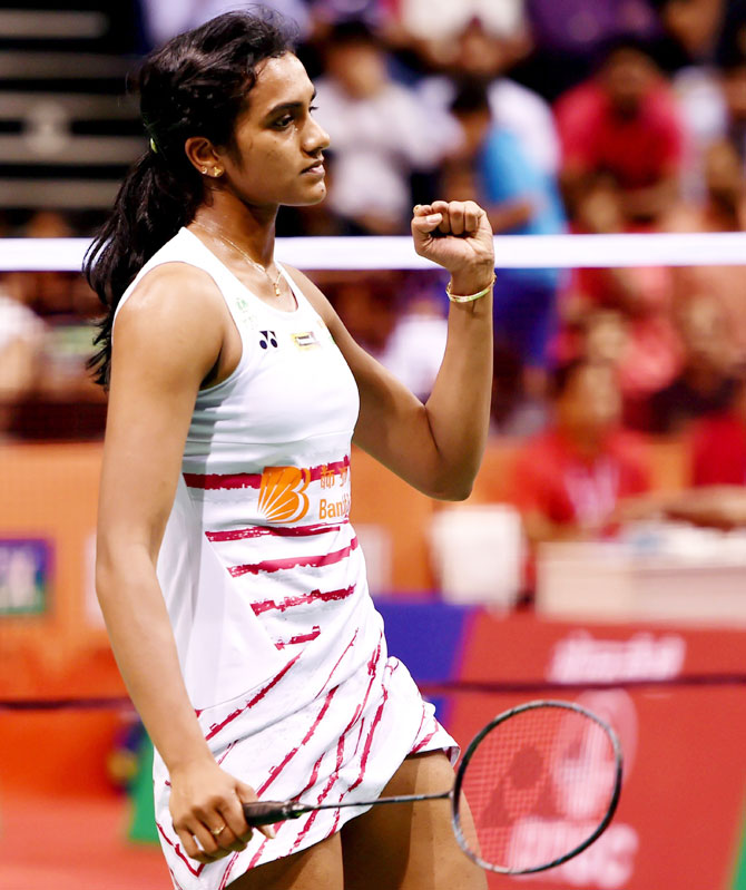 India's PV Sindhu celebrates a point during during her match against Japan's Kawakami Saena during the Women's singles match at the Yonex Sunrise India Open 2017 in New Delhi on Thursday