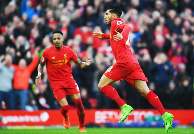 Liverpool's Emre Can (23) celebrates with Nathaniel Clyne as he as he scores their second goal against Burnley during the Premier League match at Anfield in Liverpool on Sunday