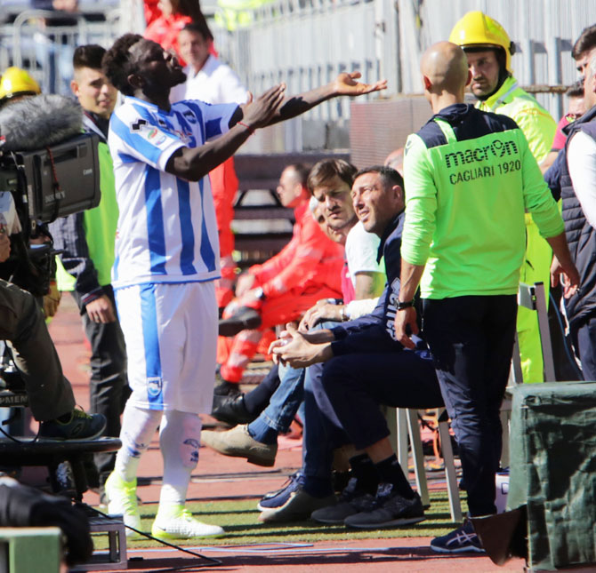 Pescara's Sulley Muntari reacts after the crowds threw racist chants in his direction during the Serie A match against Cagliari Calcio at Stadio Sant'Elia in Cagliari, Italy, on Sunday