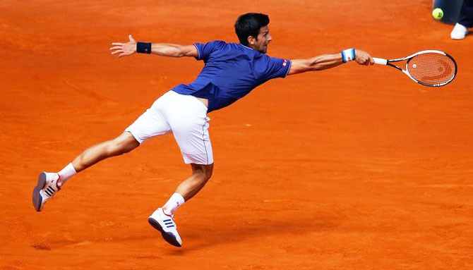 Novak Djokovic goes full stretch during his 2nd round match against Nicolas Almagro during the Madrid Open on Wednesday