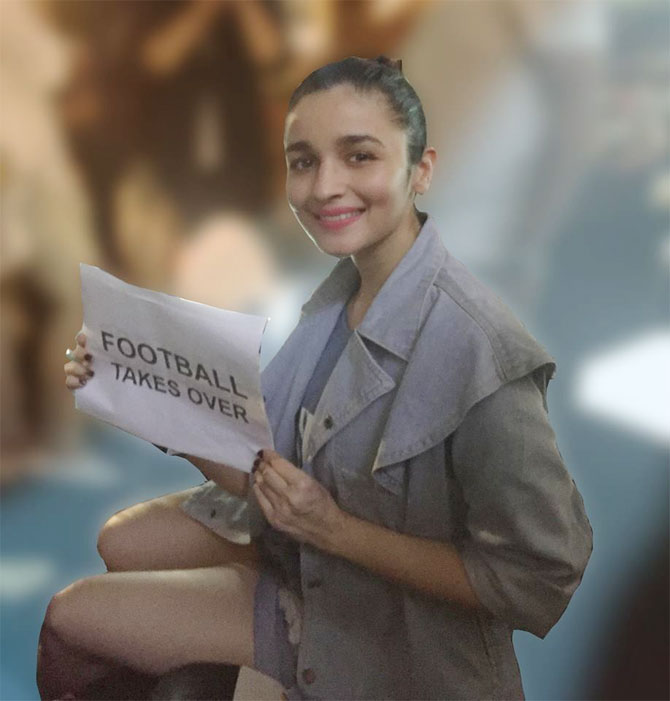 Alia Bhatt poses with a note in support of football