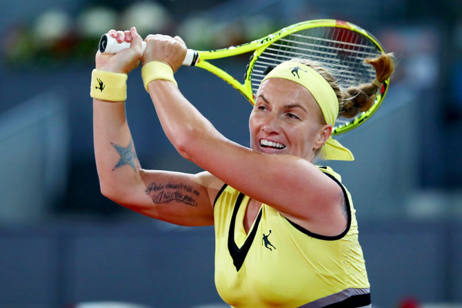 Russia's Svetlana Kuznetsova in action against Canada's Eugenie Bouchard during the Mutua Madrid Open tennis quater-final at La Caja Magica in Madrid on Thursday