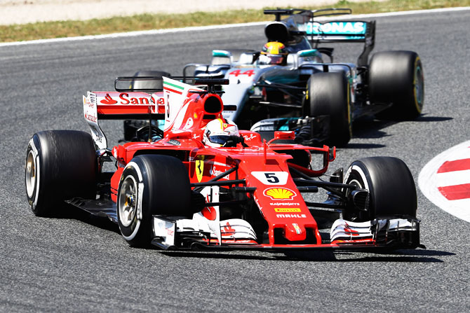 Ferrari's Sebastian Vettel leads Mercedes' Lewis Hamilton on the track