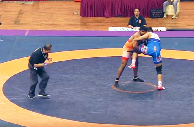 India's Sumit in action against Iran's Yadollah Mohammadkazem Mohebi