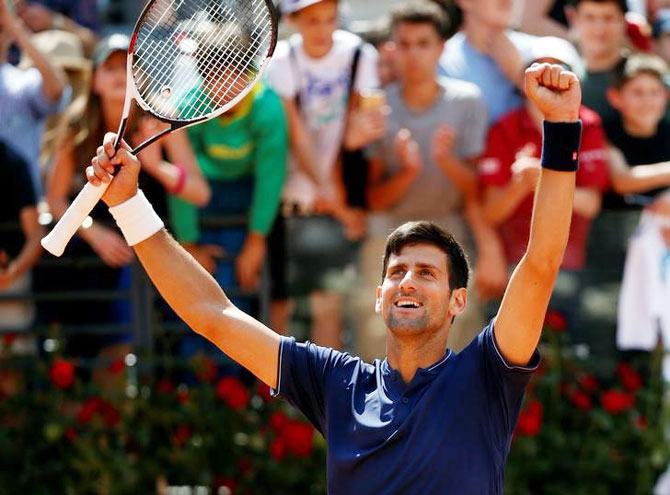 Djokovic reacts after defeating Juan Martin Del Potro in the Rome Open on Saturday