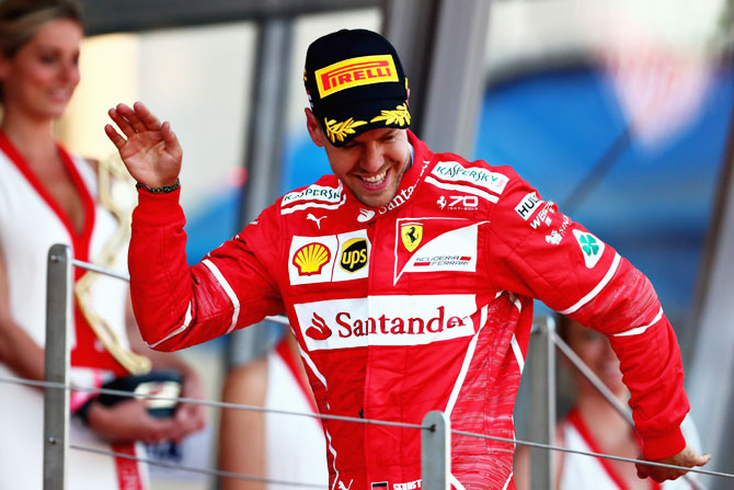 Sebastian Vettel of Germany and Ferrari celebrates on the podium after his win at the Monaco Formula One Grand Prix at Circuit de Monaco in Monte-Carlo, Monaco, on Sunday
