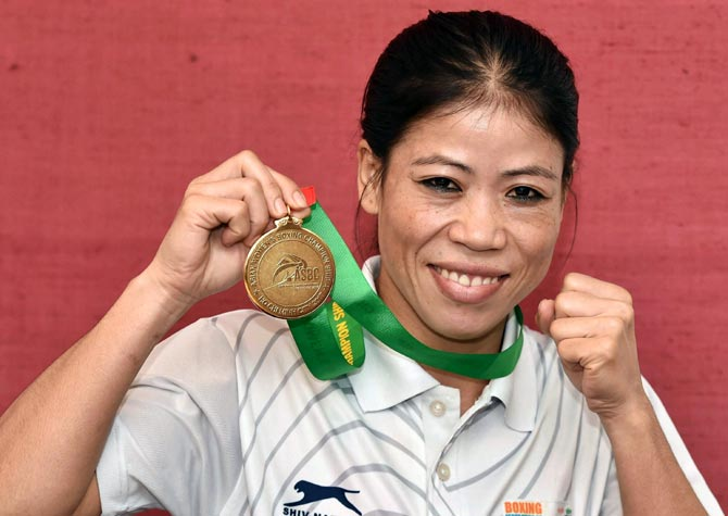 Mary Kon Boxer winning medals