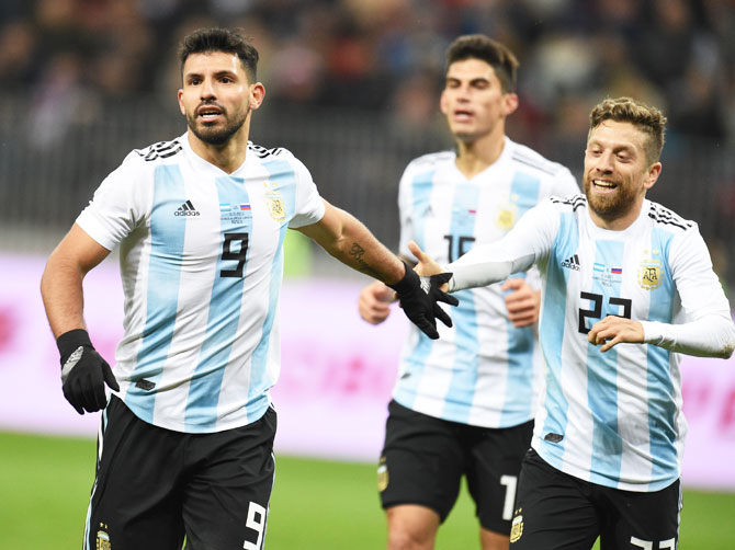Argentina's Sergio Aguero celebrates with teammate Alejandro Gomez after scoring a goal during an international friendly against Russia at Luzhniki Stadium in Moscow on Saturday