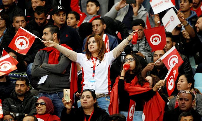 Tunisia fans celebrate after their team held Libya to a goalless draw to qualify for the 2018 FIFA World Cup on Saturday