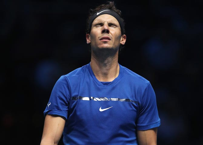 Rediff Sports - Cricket, Indian hockey, Tennis, Football, Chess, Golf - PHOTOS: Nadal's season ends in painful defeat by Goffin