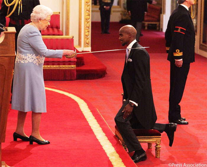 British athlete Mo Farah gets knighted by Queen Elizabeth at a ceremony on Wednesday