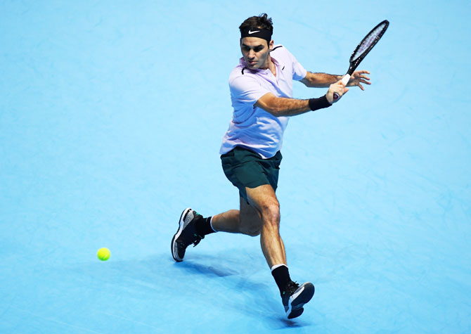 Rediff Sports - Cricket, Indian hockey, Tennis, Football, Chess, Golf - ATP Tour Finals: Perfect Federer downs Cilic