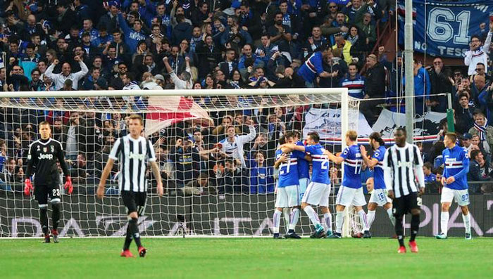 Juventus' Wojciech Szczesny and teammates are dejected as Sampdoria celebrate their third goal during their Serie A match at Stadio Comunale Luigi Ferraris, in Genoa, Italy on Sunday