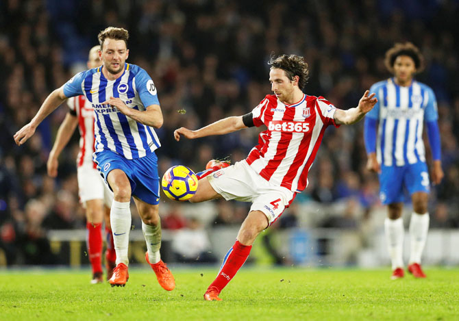 Stoke City's Joe Allen in action and Brighton's Dale Stephens in action during their English Premier League match at The American Express Community Stadium, in Brighton on Monday