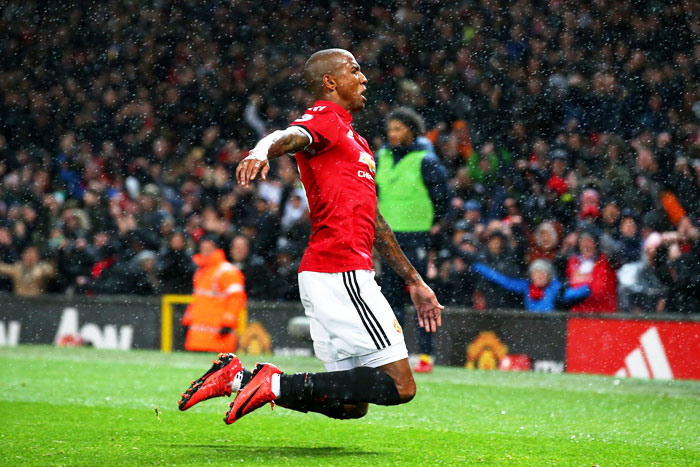 Manchester Unite's Ashley Young celebrates scoring his side's first goal against Brighton and Hove Albion during their English Premier League match at Old Trafford in Manchester on Saturday