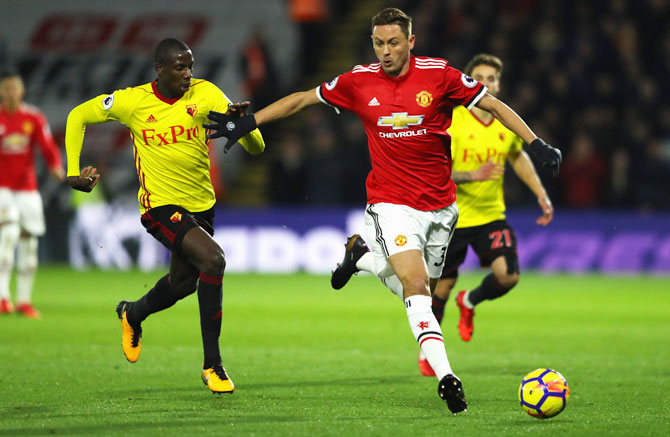 Manchester United's Nemanja Matic holds off Watford's Abdoulaye Doucoure during their match at Vicarage Road on Tuesday