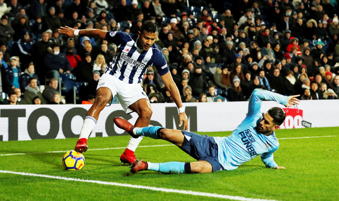West Bromwich Albion's Salomon Rondon and Newcastle United's Ayoze Perez vie for possession during their match at The Hawthorns, in West Bromwich on Tuesday