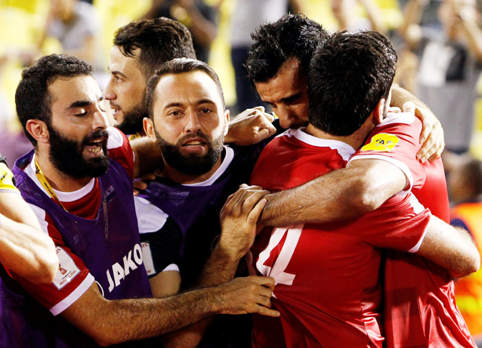 Syria's Omar Al Soma celebrates after scoring during their 2018 World Cup Qualifying Asia Zone Playoffs against Australia in Hang Jebat Stadium, Melaka, Malaysia