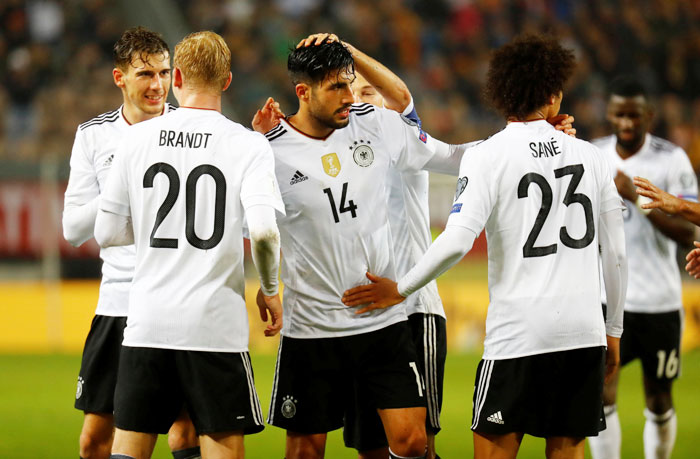 Germany's Emre Can celebrates with teammates after scoring their fifth goal against Azerbaijan at Fritz-Walter-Stadion in Kaiserslautern in Germany on Sunday