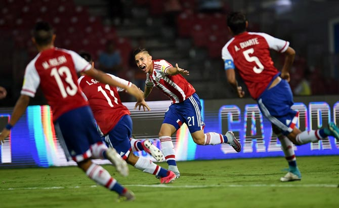 Paraguay's Alan Rodriguez, centre, celebrates after scoring a goal against New Zealand on Monday