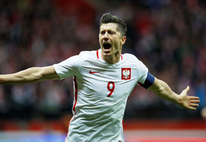 Poland's Robert Lewandowski celebrates scoring their third goal against Montenegro during their 2018 World Cup qualifiers at National Stadium Warsaw in Warsaw, Poland on Sunday
