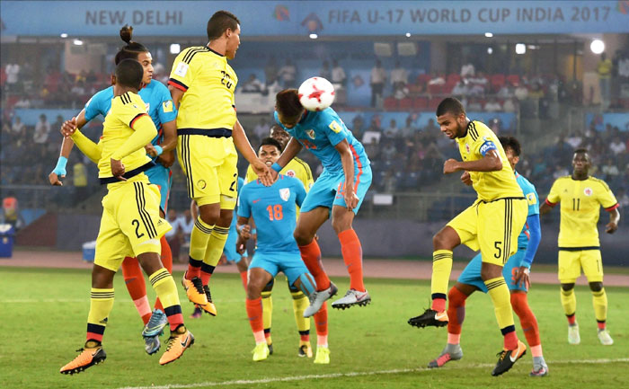 Jeakson Singh Thounaojam (15) heads to score India's first goal against Colombia during the FIFA U-17 World Cup 2017 Group A match in New Delhi on Monday