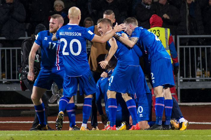 Iceland team celebrate after scoring a second goal against Kosovo