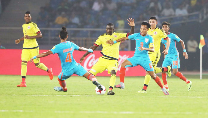India's Anwar Ali (left) takes on a Colombian player as they vie for possession